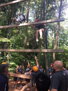 Cohort members climbing the Giant's Ladder during orientation