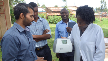 Photo of doctors and engineers discussing a piece of medical equipment.